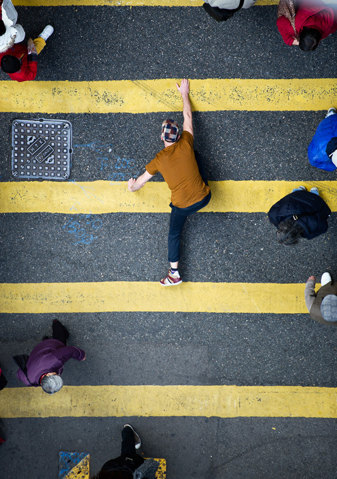 man climbing lines of pedestrian crossing