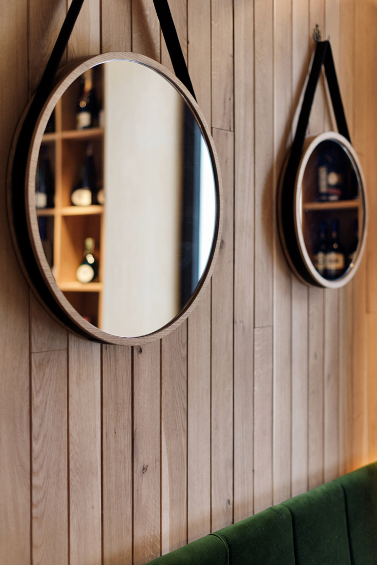 timber wall panelling, round mirror, details